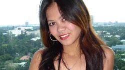 Slutty Filipina woman no longer dressed in panties underneath brief skirt